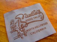 Vintage 1950 clothing label