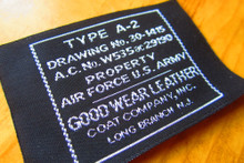 Vintage woven clothing label