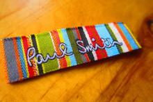 Multiple color ARCO woven damask label