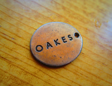 Distressed antique copper metal clothing label