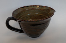 Medium batter bowl shown here with iron lustre glaze inside and turtle shell outside.