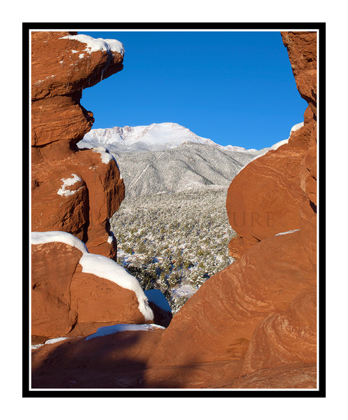 Pikes Peak over Siamese Twins Covered in Snow in Garden of the Gods in Colorado Springs, Colorado 2421