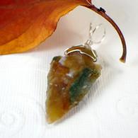 Arrowhead pendant green mottled wire wrapped in sterling silver