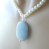 Light blue gemstone pendant necklace with white pearl strand 17 inch