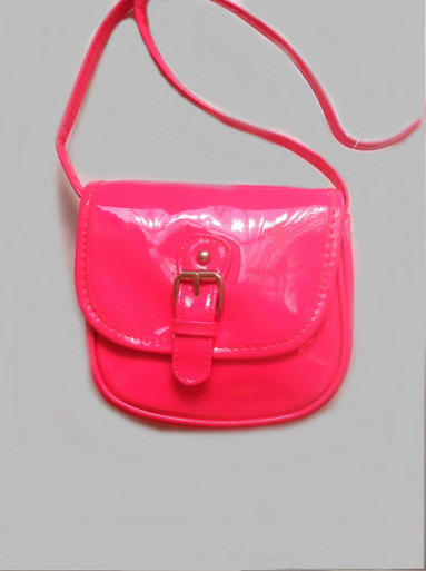 "Your little one will be darling with this fashionable faux patent leather hot pink travel crossbody purse. Cute, and affordable too mom!  Front Buckle  Adjustable crossbody shoulder strap Body of bag is, approx. 6"" W X 5.5 L Adjustable strap"