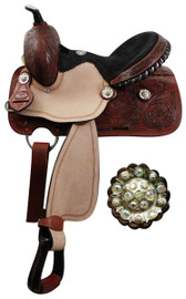 """13"""" Youth Double T barrel saddle with fully tooled pommel, skirts and cantle. Saddle features crystal rhinestone conchos, roughout fenders and jockies, rawhide braided horn, and a black suede seat with a black rawhide cantle with silver inlay. Saddle features inskirt rigging and close contact skirts. Comes with a leather latigo tie strap and off billet."""