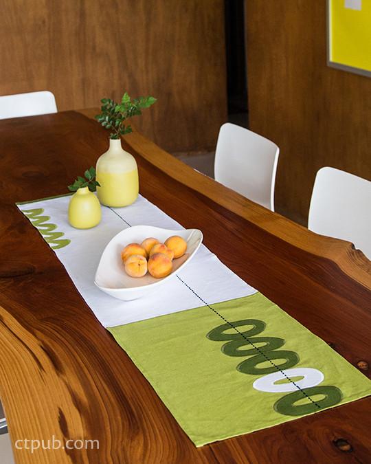 """Linen Table Runner"" in the book URBAN SCANDINAVIAN SEWING 18 Seasonal Projects for Modern Living by Kirstyn Cogan #urbanscandinaviansewing #kirstyncogan #ctpublishing #stashbooks #modern #nordic #applique #linen #tablerunner"