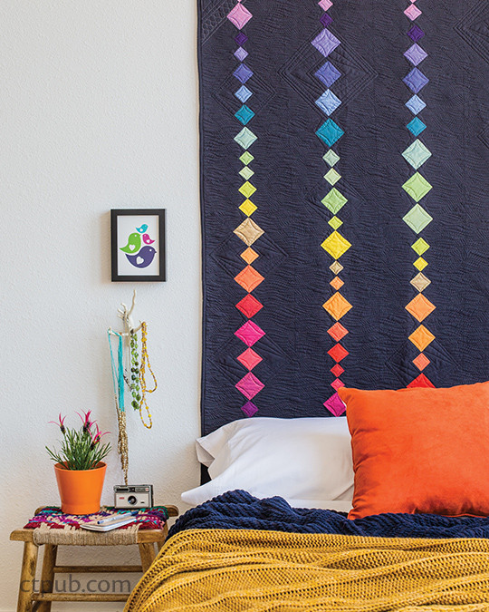 """""""The Impossible Rainbow"""" from the book MODERN RAINBOW by Rebecca Bryan, quilted by Angela Walters 14 Imaginative Quilts That Play with Color #modernrainbow #ctpublishing #stashbooks #modernquilting #roygbiv #angelawalters #rebeccabryan #quilting #improv #rainbowismyfavoritecolor"""