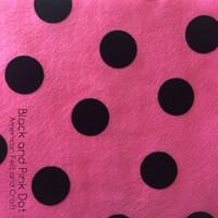 Black dot on pink printed felt
