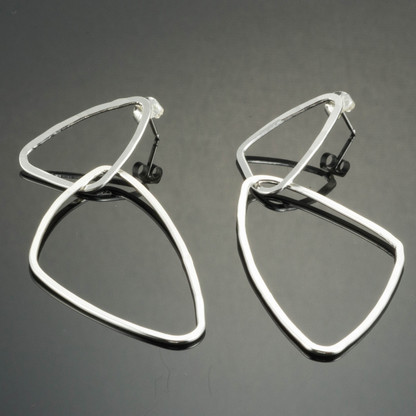 Interlocking sterling silver triangle earrings.