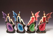 Four assorted fairies on faux geode