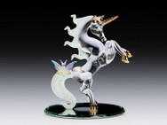 Jumping unicorn with butterfly on mirror base