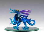 Proud blue dragon on oval mirror base