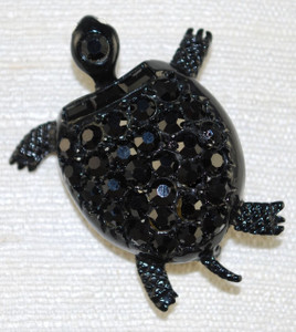 Front view of Designer vintage turtle jet crystal pin