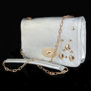 Front view of Silver handbag/Shoulder bag, w/ gold accents