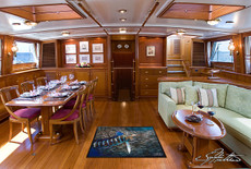 Fine art boat mats by renowned artist Jason Mathias. This beautiful welcome aboard mat features a beautiful Striped Marlin and baitball by Jason Mathias and is sure to dress up your yacht or boat, making for a unique  presentation.  Mats should not be placed into a cloths washer or dryer. They should be washed using a scrub brush and BLEACH FREE laundry detergent, rinsed and lined dried. We recommend spray on carpet cleaner used according to the directions on the can. You can safely hose off the mats as you wish.  Mats should not be left out in direct sunlight as the art will fade.