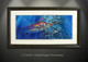 """Blue Mirage"" framed prints, by artist Jason Mathias masterfully portrays a brilliant Blue Marlin completely lit up and full of color as he balls up a massive school of Tuna."