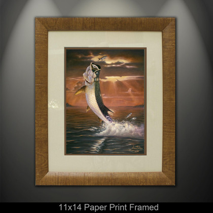 """Framed prints"" by artist Jason Mathias masterfully portrays a shimmering Tarpon framed against a blazing sunset as it leaps for a Silver Mullet. This item features ""Golden Moment"" in a Mini framed giclee paper print. Print size is ""11x14"", frame size is ""19x22"". Beautifully framed with a nice honey color wood finish and professionally doubble matted for that high end museum quality fine art look."
