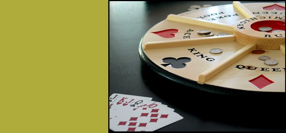 "Our 18"" Wooden Michigan Rummy game revolves on a lazy susan!"