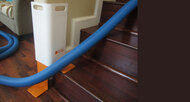 "Product Info  To prevent hoses from damaging the corner wall of the stairs we have developed a unique guard that fits most ""L"" shaped stairs.  The DUK GUARD features:      Adjustable legs     Lightweight     Easy to use     Portable     Durable"