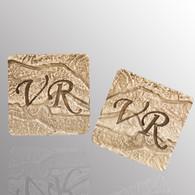 Silver cufflinks with a customized monogram.  15X15mm.