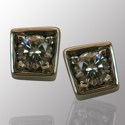 14K white gold stud earrings with 1/3ct. diamond.  4.5X4.5mm.