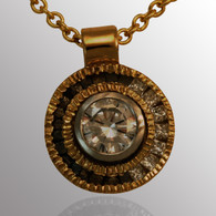 18K yellow gold and platinum pendant with 1/3ct. center diamond and 0.15ct. side diamonds.  11mm wide.