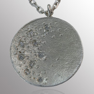 Sterling silver pendant with 1/5ct. diamond.  19mm wide.