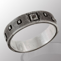 Silver men's ring with 3pt. raw cut diamond.  5.7mm wide.