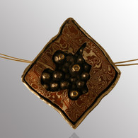 18K yellow gold, sterling silver and copper pendant with 5pt. diamond and adjustable chain.  30X30mm.