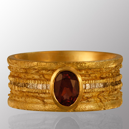 18K yellow gold ring with 0.7ct. diamond and red sapphire.  6.4mm wide.