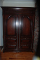 Sub zero frig hidden behind custom made French style armoire