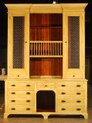 Dinsmore dresser with plate rack and wire screen door panels.