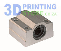 Linear bearing with housing