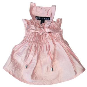 Comfortable elastic bodice and adjustable straps make these versitile dresses a staple for any dog's closet.  Dresses also may be layered under many of our denim harness vests.