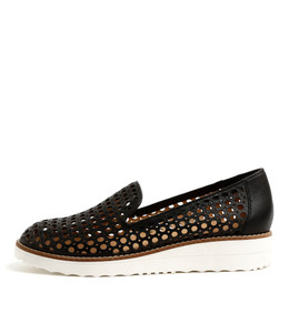 OSTA Flatforms in Black Leather