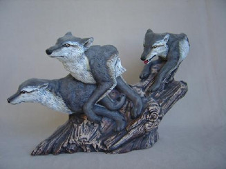 Running wolves wood carved look