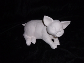 Scioto medium laying pig ready to paint ceramic bisque 9x4""