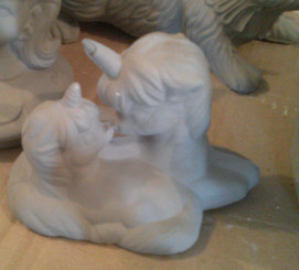 Mama and baby unicorn kissing ceramic bisque