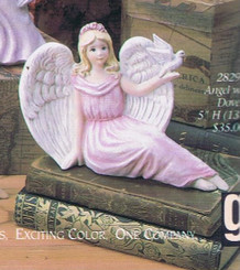 "Gare 2829  angel with dove 5"" tall  ceramic  bisque ready to paint"
