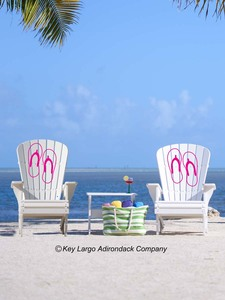 The Conch Key Adirondack Set comes with two chairs with your choice of designs on each chair, along with an accessory table.