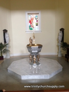 metal baptismal font
