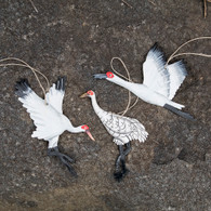 Set of three Whooping Cranes made from recycled steel drums in Haiti