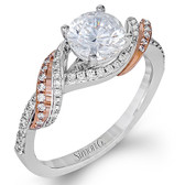 Simon G. Fabled Colletion in 18K white and rose gold. An eye-catching two-tone overlay design highlights this striking engagement ring set with .31 ctw of brilliant white diamonds.  Also available in Platinum, 18K White Gold, or 18K Gold. Can accommodate a variety of center diamond sizes, starting at 0.50 carats. Can accommodate different diamond cuts, available by special order.