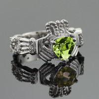 White Gold Claddagh Diamond Engagement Ring with its heart-shaped green Peridot gemstone.