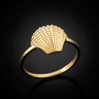 Gold seashell ring.