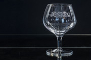 A single brandy glass with Julia Ashby Smyth's Ellan Vannin design