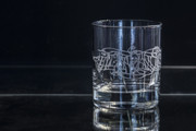 A single Whisky glass with Julia Ashby Smyth's Ellan Vannin design