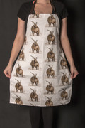 Cotton apron featuring a repeated Manx Loaghtan sheep design by Manx artist Meriel Burden