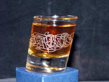 A single slanted shot glass with Julia Ashby Smyth's Ellan Vannin design - full